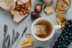 Flat lay composition: Herbal tea, almonds, grapes, honey, figs, Royalty Free Stock Photo