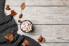 Flat lay composition with hot cozy drink and autumn leaves on wooden background. Flat lay composition with hot cozy drink and aun leaves on wooden background stock photo