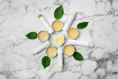 Flat lay composition with hygienic lipsticks and balms royalty free stock images
