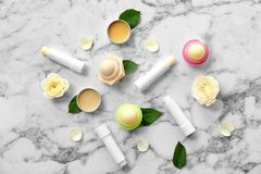 Flat lay composition with hygienic lipsticks royalty free stock image