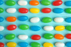 Flat lay composition with jelly beans. On color background stock photography