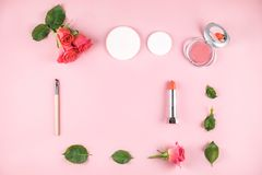 Flat lay composition with lipstick, blush, flowers. royalty free stock photos
