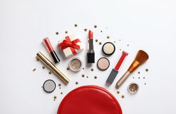 Flat lay composition with makeup products and Christmas decor stock photos