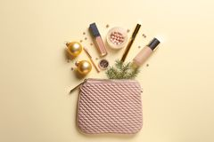 Flat lay composition with makeup products and Christmas decor royalty free stock images