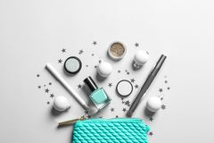 Flat lay composition with makeup products and Christmas decor. On white background royalty free stock photography