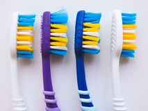 Flat lay composition with manual toothbrushes on white background.Toothbrush and toothpaste.op view, flat lay. Minimal concept,. Space for text.set of royalty free stock photo