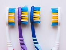 Flat lay composition with manual toothbrushes on white background.Toothbrush and toothpaste.op view, flat lay. Minimal concept,. Space for text.set of stock photography