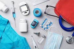 Flat lay composition with medical objects on grey. Background royalty free stock photos