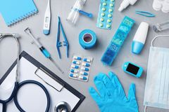 Flat lay composition with medical objects on grey. Background royalty free stock photography