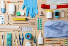 Flat lay composition with medical objects. On wooden background royalty free stock photo