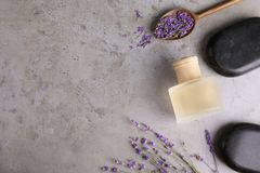 Flat lay composition with natural herbal oil and lavender flowers on color background. Space for text stock photos
