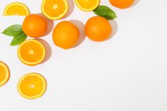 Flat lay composition with oranges and space for text on white background. Top view royalty free stock image