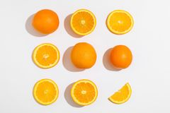 Flat lay composition with oranges on white background royalty free stock image