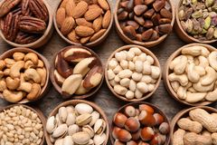 Flat lay composition with organic nuts on wooden background, top view. royalty free stock photos
