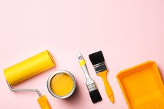 Flat lay composition with paint can, decorator tools and space for text. On color background stock images