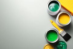 Flat lay composition with paint cans and brush on grey. Space for text. Flat lay composition with paint cans and brush on grey background. Space for text stock image