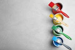 Flat lay composition with paint cans and brushes. On light background. Space for text royalty free stock image