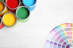 Flat lay composition with paint cans and color palette on wooden background. Space for text stock photo