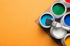 Flat lay composition with paint cans on color background. Flat lay composition with paint cans and space for text on color background stock image