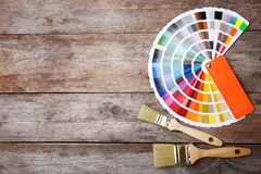 Flat lay composition with paint color palette and brushes on wooden background. Space for text royalty free stock images