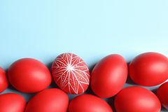 Flat lay composition of painted red Easter eggs on color background. Space for text royalty free stock images