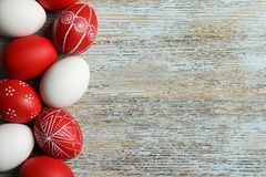 Flat lay composition of painted red Easter eggs on table, space for text. Flat lay composition of painted red Easter eggs on wooden table, space for text stock images