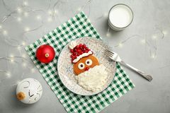 Flat lay composition with pancakes in form of Santa Claus. On grey background. Christmas breakfast ideas for kids Royalty Free Stock Image