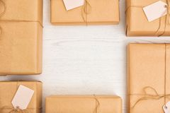Flat lay composition with parcels and space for text. On wooden background royalty free stock image