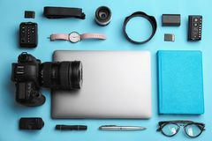 Flat lay composition with photographer`s equipment and accessories. On color background stock photography