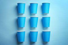 Flat lay composition with plastic cups on color background. Table setting stock photography