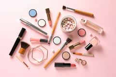 Flat lay composition with products for decorative makeup. On pastel pink background stock image
