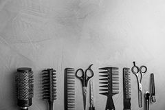Flat lay composition with professional hairdresser tools. On grey background stock image