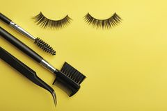 Flat lay composition of professional makeup tools and false eyelashes on color background stock photo