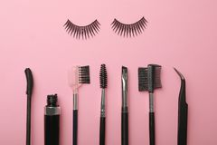 Flat lay composition of professional makeup tools and false eyelashes stock photos