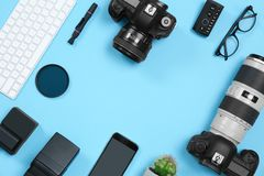 Flat lay composition with professional photographer equipment and space for text. On color background stock images