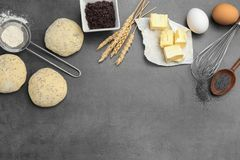 Flat lay composition with raw dough and ingredients. On grey background Royalty Free Stock Images