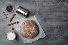 Flat lay composition with raw dough and product. S on grey background Royalty Free Stock Photography