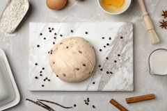 Flat lay composition with raw dough and products. On grey background Royalty Free Stock Photo