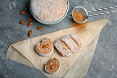 Flat lay composition with raw rye dough and almonds. On grey background Royalty Free Stock Image