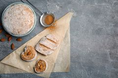 Flat lay composition with raw rye dough. And almonds on grey background Royalty Free Stock Image