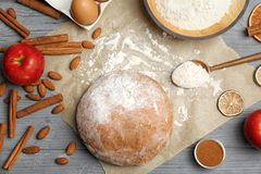 Flat lay composition with raw rye dough. And ingredients on wooden background Stock Images