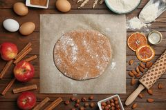 Flat lay composition with raw rye dough. And ingredients on wooden background Royalty Free Stock Photography