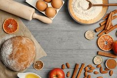 Flat lay composition with raw rye dough and ingredients. On wooden background Stock Photo