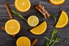 Flat lay composition with ripe citrus fruits, cinnamon sticks and rosemary on wooden background stock image