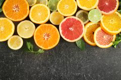 Flat lay composition with ripe citrus fruits on dark background stock photos