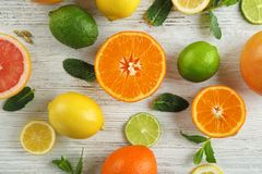 Flat lay composition with ripe citrus fruits on light background royalty free stock images