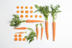 Flat lay composition with ripe fresh carrots. On white background royalty free stock photo