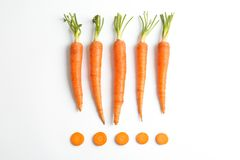 Flat lay composition with ripe fresh carrots. On white background royalty free stock images