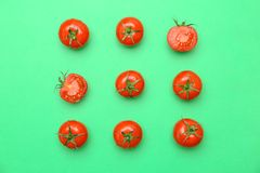 Flat lay composition with ripe tomatoes. On color background Stock Images