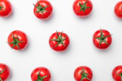 Composition with ripe tomatoes on light background. Flat lay composition with ripe tomatoes on light background Royalty Free Stock Image